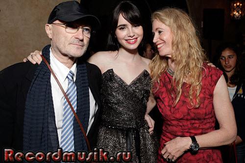 Фил Коллинз с женой и дочкой